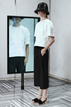 Resort 2014 Between the fancy bucket hats and coiled-wire details, Wang's first resort outing managed to mix his youthful aesthetic with the brand's archival designs.