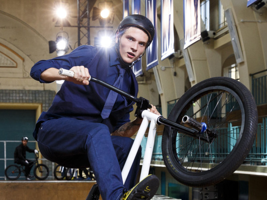 LONDON, ENGLAND - JUNE 15:  A model rides a BMX during the Jimmy Choo presentation during The London Collections Men SS16 at Seymour Liesure Centre on June 15, 2015 in London, England.  (Photo by Tristan Fewings/Getty Images)