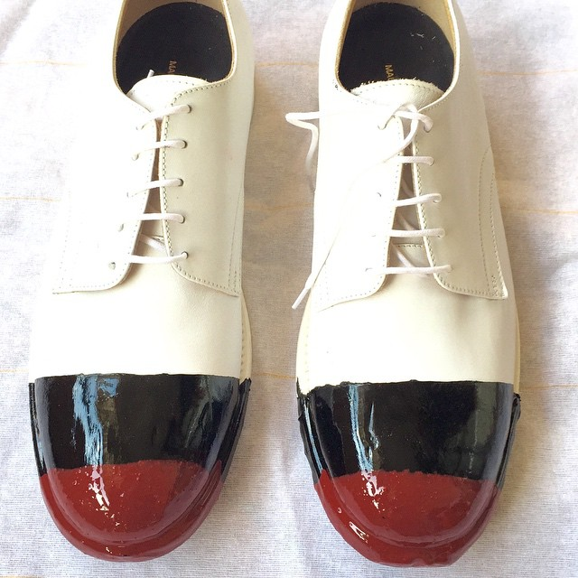 Handmade shoes dipped in rubber.  Made to order